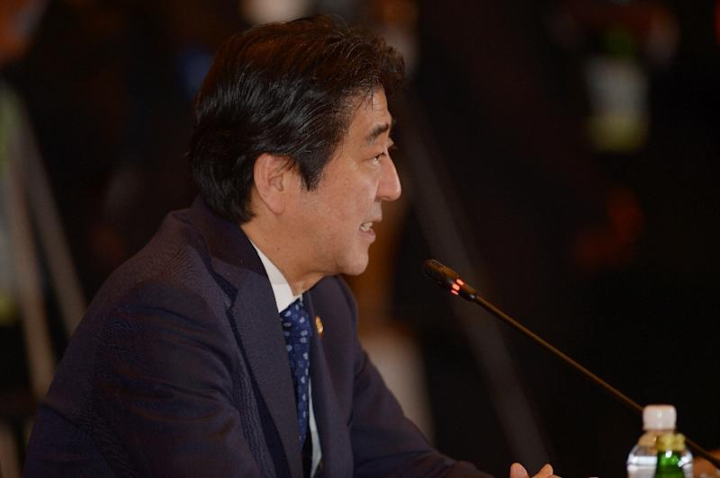 Japan's Prime Minister Shinzo Abe is to come under fresh pressure from the results as his programme of big spending and massive monetary easing, aimed at kick-starting growth and ending deflation, struggles to kick in (AFP Photo/Adek Berry)