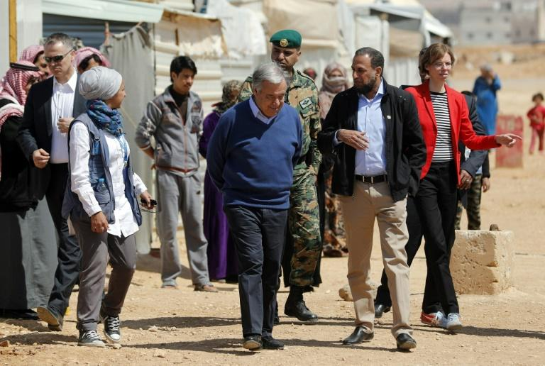 United Nations Secretary General Antonio Guterres (C) walks during a visit to the Zaatari refugee camp which shelters some 80,000 Syrian refugees on the Jordanian border with war-ravaged Syria on March 28, 2017
