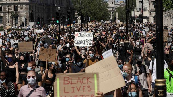 PHOTO: People march through Parliament Square in central London, May 31, 2020, to protest against the recent killing of George Floyd by police officers in Minneapolis. (Matt Dunham/AP)