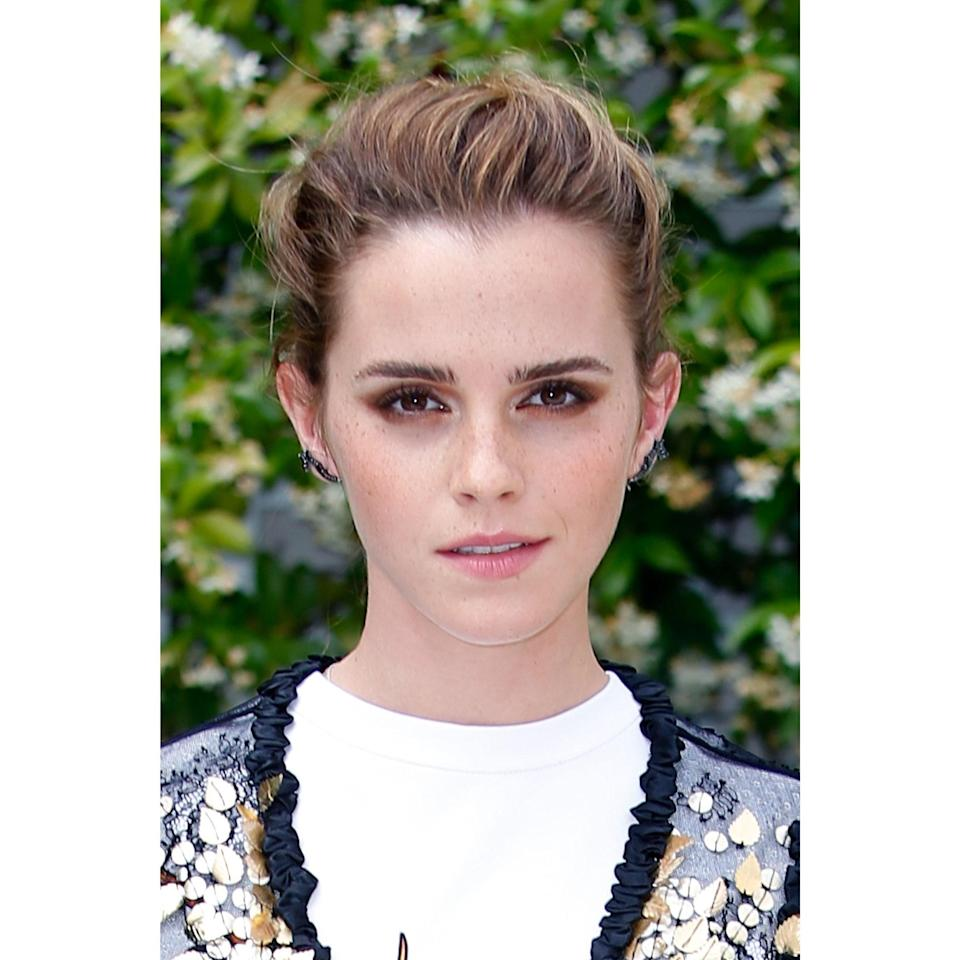 """<a href=""""http://allure.com/topic/emma-watson"""" rel=""""nofollow noopener"""" target=""""_blank"""" data-ylk=""""slk:Emma Watson"""" class=""""link rapid-noclick-resp"""">Emma Watson</a>'s style has a ton of versatility depending on both your length and texture. But the main thing to keep in mind is this: Comb your straight/wavy/curly hair back, pinch tiny bits with your fingertips, and pin them with bobby pins pushed straight back (that is, not horizontal). The result is this sweet and traditional hairstyle, which takes minimal effort to create."""