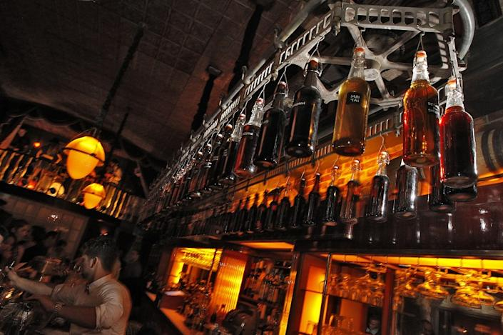 """Bottles hang from a rotating delivery mechanism over the bar at Sassafras Saloon in Hollywood. <span class=""""copyright"""">(Robert Gauthier / Los Angeles Times)</span>"""