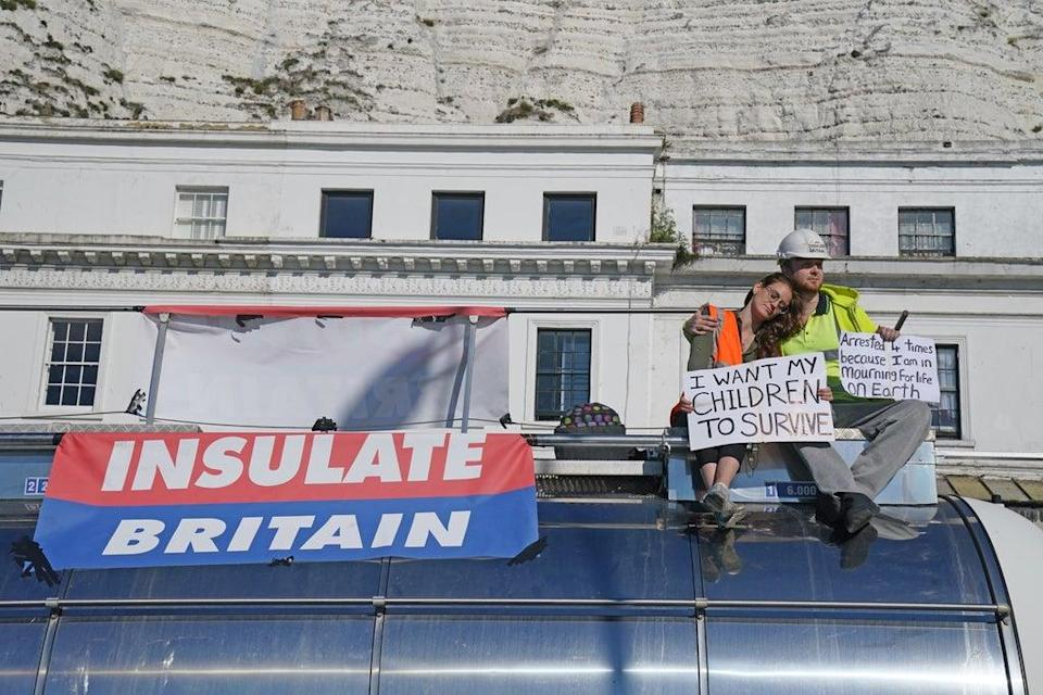 Protesters from Insulate Britain sit on top of a vehicle as they block the A20 in Kent, which provides access to the Port of Dover in Kent (Gareth Fuller/PA) (PA Wire)