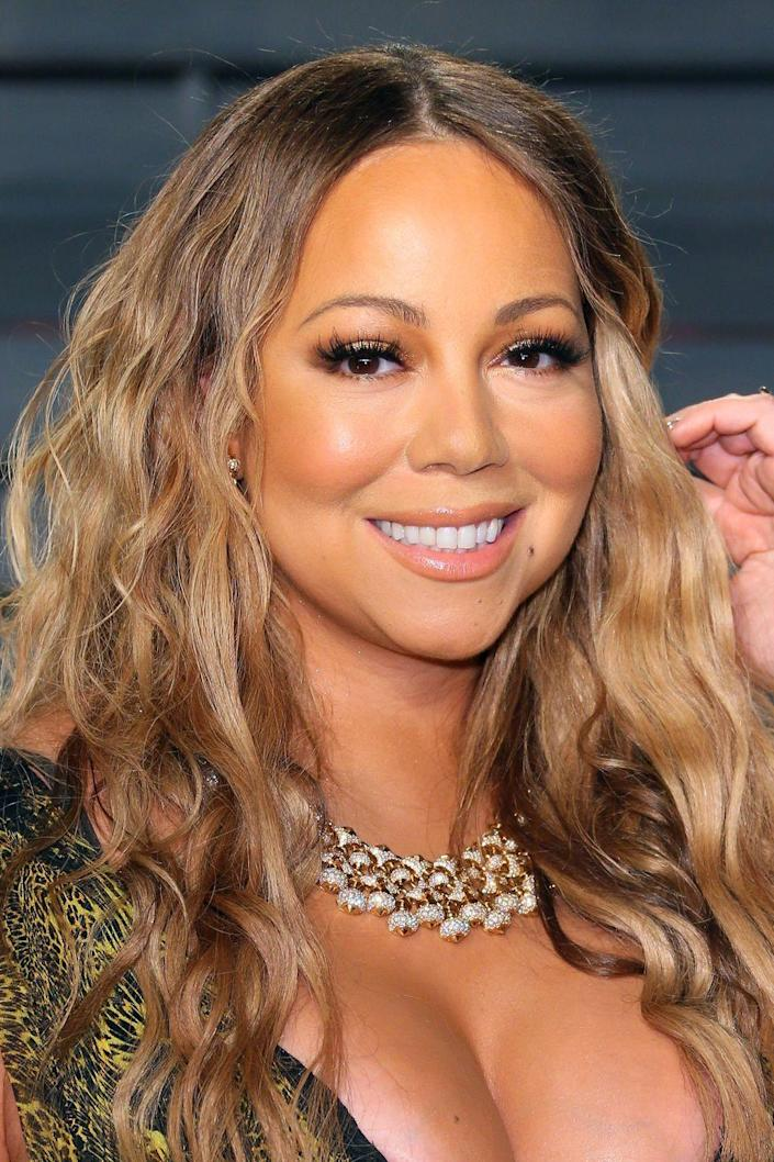 """<p>Mariah Carey's hair has been the color of honey ever since ... well ... <em><a href=""""https://www.amazon.com/Honey/dp/B00136NS7C/ref=sr_1_1?tag=syn-yahoo-20&ascsubtag=%5Bartid%7C10050.g.4942%5Bsrc%7Cyahoo-us"""" rel=""""nofollow noopener"""" target=""""_blank"""" data-ylk=""""slk:Honey"""" class=""""link rapid-noclick-resp"""">Honey</a>.</em> <span class=""""redactor-invisible-space"""">But it hasn't always been that way.</span></p>"""