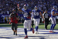 New York Giants running back Saquon Barkley (26) celebrates after scoring a touchdown during the second half of an NFL football game against the Atlanta Falcons, Sunday, Sept. 26, 2021, in East Rutherford, N.J. (AP Photo/Seth Wenig)