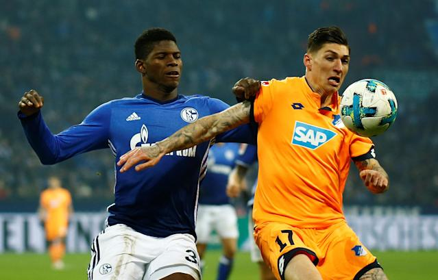 Soccer Football - Bundesliga - Schalke 04 vs TSG 1899 Hoffenheim - Veltins-Arena, Gelsenkirchen, Germany - February 17, 2018 Hoffenheim's Steven Zuber in action with Schalke's Breel Embolo REUTERS/Leon Kuegeler DFL RULES TO LIMIT THE ONLINE USAGE DURING MATCH TIME TO 15 PICTURES PER GAME. IMAGE SEQUENCES TO SIMULATE VIDEO IS NOT ALLOWED AT ANY TIME. FOR FURTHER QUERIES PLEASE CONTACT DFL DIRECTLY AT + 49 69 650050