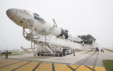 SpaceX Falcon 9 rocket with the company's Crew Dragon spacecraft on board as it is rolled out - Credit: NASA/JOEL KOWSKY/AFP/Getty Images