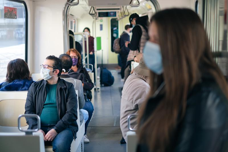 27 April 2020, Lower Saxony, Hanover: Passengers wear a mouthguard on the light rail system. Since Monday, masks have been mandatory in Lower Saxony for public transport and shops. Photo: Ole Spata/dpa (Photo by Ole Spata/picture alliance via Getty Images)
