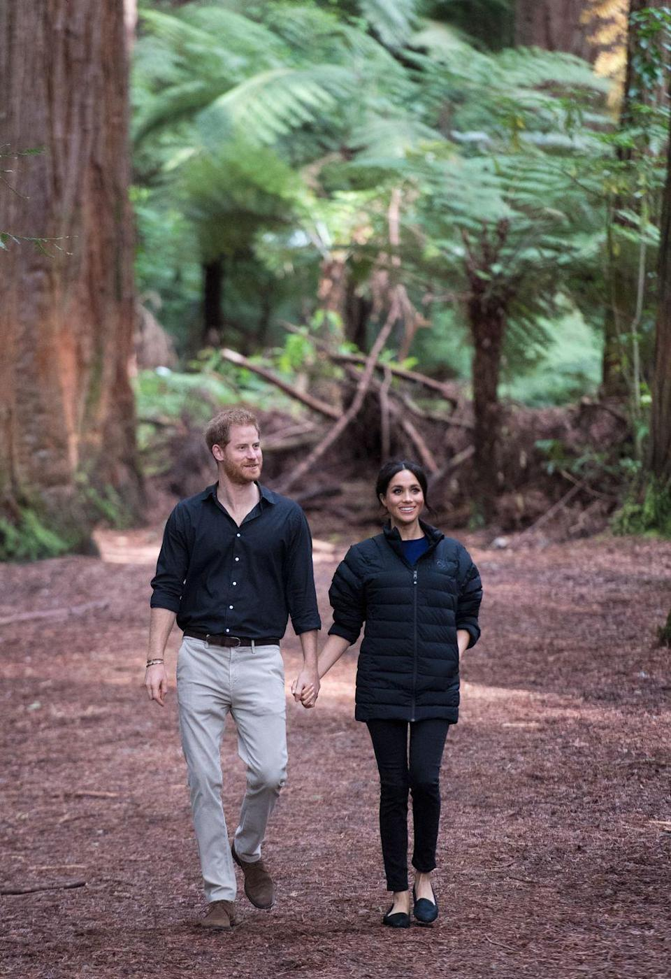 <p>The Duchess of Sussex bundled up in Prince Harry's waterproof jacket during their visit of the Redwoods Forest at Rotorua, New Zealand. </p>