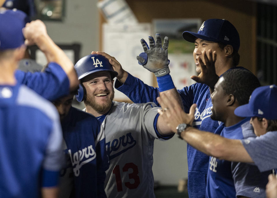 The Dodgers play 13 of their next 15 games at home. (AP)