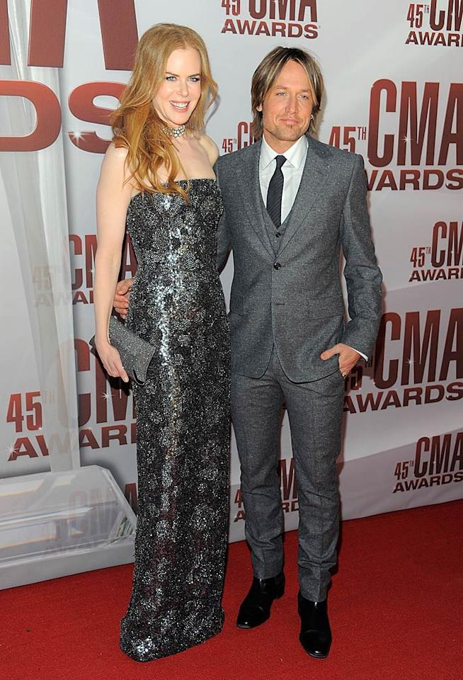 Keith Urban, who always seems to wear gray, rocked a wool suit, while wife Nicole Kidman decided to don a metallic gown and diamond choker. (11/9/2011)