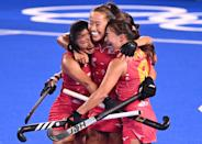 <p>Japan's Shihori Oikawa (center) celebrates with her teammates after scoring against New Zealand during their women's pool B match field hockey competition on July 26. </p>