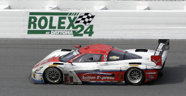 Sebastian Bourdais, of France, drives the Action Express Racing Corvette DP through the front stretch during the IMSA Series Rolex 24 hour auto race at Daytona International Speedway in Daytona Beach, Fla., Sunday, Jan. 26, 2014.(AP Photo/John Raoux)