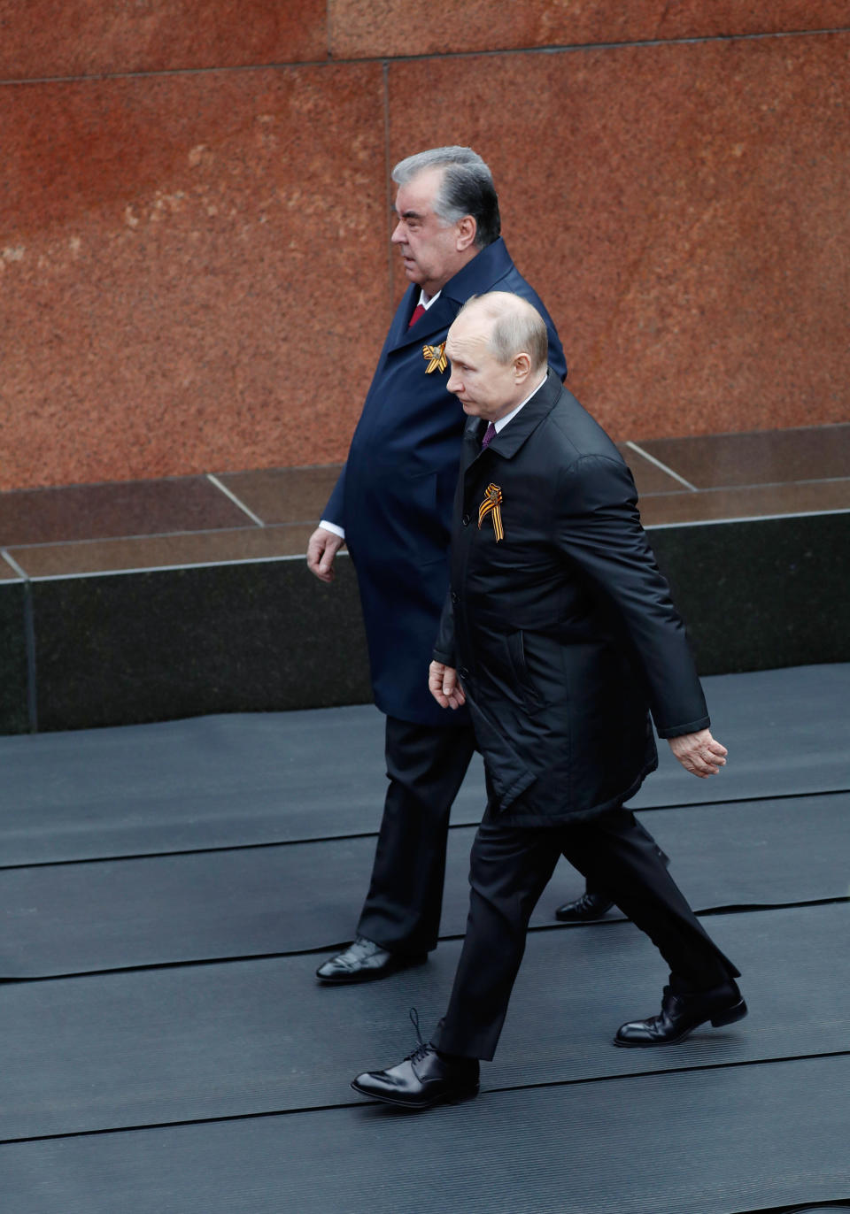 Russian President Vladimir Putin, right, and Tajikistan's President Emomali Rakhmon walk before the Victory Day military parade in Moscow, Russia, Sunday, May 9, 2021, marking the 76th anniversary of the end of World War II in Europe. (Dmitry Astakhov, Sputnik, Kremlin Pool Photo via AP)