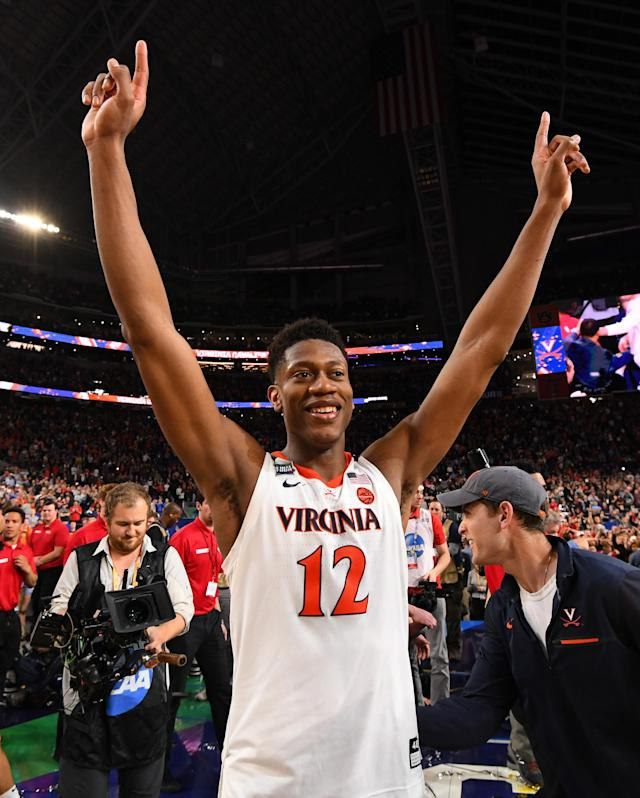 De'Andre Hunter #12 of the Virginia Cavaliers celebrates after defeating the Texas Tech Red Raiders in the 2019 NCAA men's Final Four National Championship game at U.S. Bank Stadium on April 08, 2019 in Minneapolis, Minnesota. (Photo by Jamie Schwaberow/NCAA Photos via Getty Images)