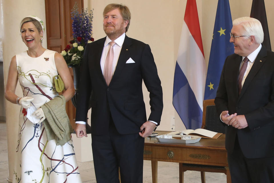 German president Frank-Walter Steinmeier, right, welcomes King Willem-Alexander of the Netherlands and Queen Maxima at the Bellevue palace in Berlin, Germany, Monday, July 5, 2021. The Royals arrived in Germany for a three-day visit that was delayed from last year because of the coronavirus pandemic. (Wolfgang Kumm/dpa via AP)