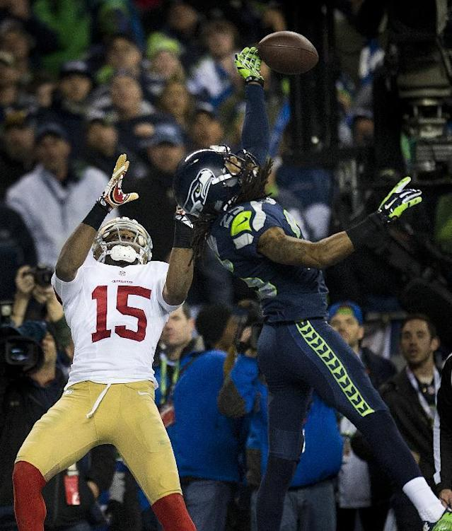 CORRECTS BYLINE TO PAUL KITAGAKI JR.-Seattle Seahawks cornerback Richard Sherman (25) hits the ball away from San Francisco 49ers wide receiver Michael Crabtree (15) and is intercepted by Seattle Seahawks outside linebacker Malcolm Smith (53) during the NFL football NFC Championship game, Sunday, Jan. 19, 2014, in Seattle. The Seahawks won 23-17 to advance to the Super Bowl. (AP Photo/The Sacramento Bee, Paul Kitagaki Jr.)