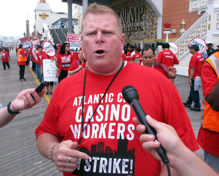 In this July 1, 2016 photo, Bob McDevitt, left, president of Local 54 of the Unite Here casino workers union, speaks to reporters outside the Trump Taj Mahal casino in Atlantic City N.J. hours after the union went on strike against the casino, which was owned by billionaire investor Carl Icahn. On Wednesday, April 10, 2019, McDevitt's union called on casino regulators in New Jersey, Nevada and Ohio to protect casino workers from hedge fund or private equity firms that own casinos if they seek to quickly extract profits from the properties while hurting workers. (AP Photo/Wayne Parry)