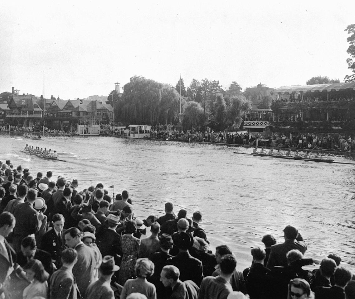 The U.S. Summer Olympic rowing team (extreme far left) is seen winning their sixth successive victory in the eighths at Henley-On-Thames August 9, 1948 in 5 minutes, 56.7 seconds.  The Americans were represented by a California University crew.  Britain, represented by a Cambridge University crew were second and a Norwegian crew third.  The U.S. is seen leading from Great Britain and Norway (right). Summer Olympic Games, London, England 1948. (AP Photo/stf)