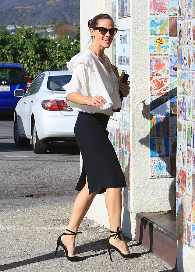 <p>The busy mom and actress looked glam for church on Sunday in L.A., as she toted her own Bible with her. (Photo: BG004/Bauer-Griffin/GC Images) </p>
