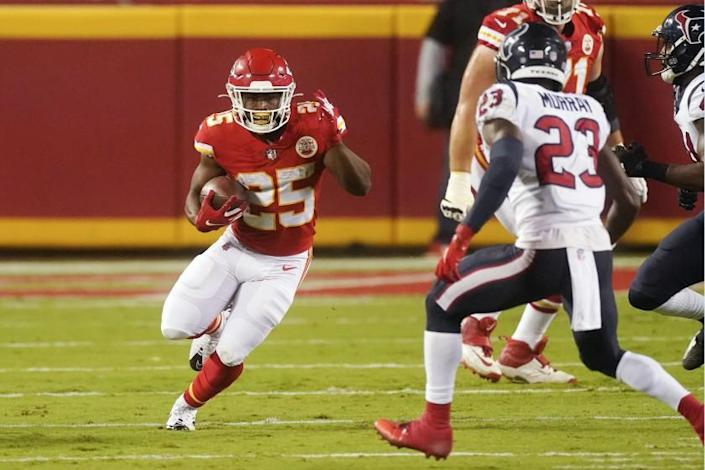 """Kansas City Chiefs running back Clyde Edwards-Helaire (25) carries the ball against Houston Texans safety Eric Murray (23) in the first half of Thursday night's NFL season-opening game in Kansas City, Mo. <span class=""""copyright"""">(Associated Press)</span>"""