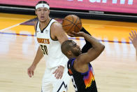 Phoenix Suns guard Chris Paul (3) shoots as Denver Nuggets forward Aaron Gordon (50) looks on during the second half of Game 1 of an NBA basketball second-round playoff series, Monday, June 7, 2021, in Phoenix. (AP Photo/Matt York)