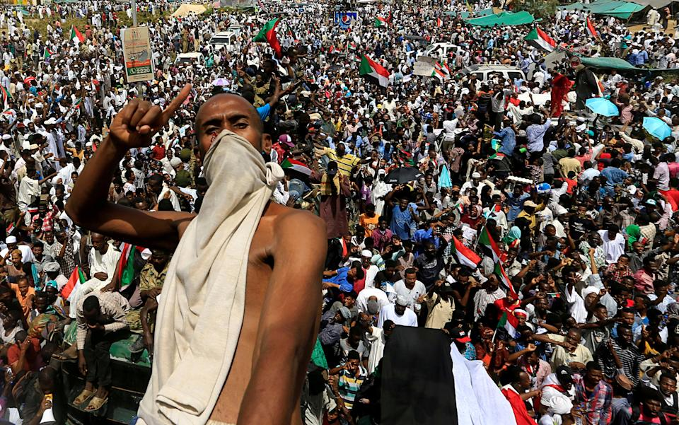 A Sudanese demonstrator gestures while riding atop a military truck as he protests against the army's announcement that President Omar al-Bashir would be replaced by a military-led transitional council, near Defence Ministry in Khartoum, Sudan April 12, 2019. REUTERS/Stringer TPX IMAGES OF THE DAY