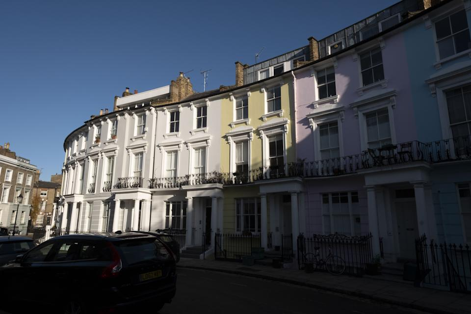 Rows of coloured residential townhouses stand on a crescent in the Primrose Hill area of London, U.K., on Friday, Nov. 29, 2019. Photo: Bryn Colton/Bloomberg