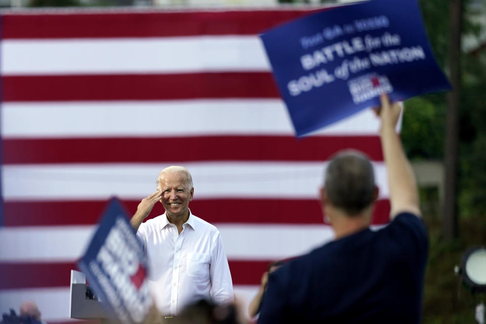 Democratic presidential candidate former Vice President Joe Biden greets supporters at a drive-in rally at Cellairis Amphitheatre in Atlanta, Tuesday, Oct. 27, 2020. (AP Photo/Andrew Harnik, File)