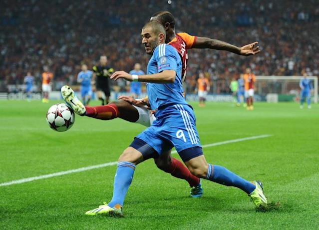 Aurelien Chedjou of Galatasaray, background centre, vies for the ball with Karim Benzema of Real Madrid, during their Champions League Group B soccer match, in Istanbul, Turkey, Tuesday, Sept. 17, 2013. (AP Photo)