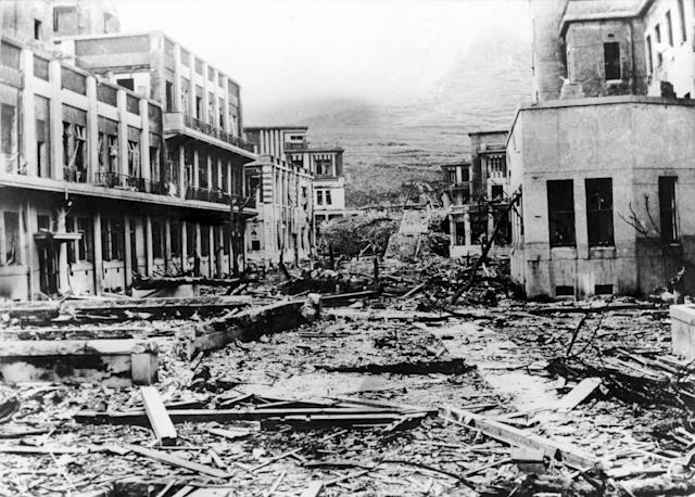 <p>General view in July 1946 of the Nagasaki Medical School in Japan. It was located at about one kilometer from where the American atomic bomb was dropped. The structure of the buildings held but debris and fallen trees are everywhere. One year after the explosion, the ruins of the bombing are still in evidence. The city, which is still radio-active, has been deserted by the survivors. (Photo: Keystone-France/Gamma-Keystone via Getty Images) </p>