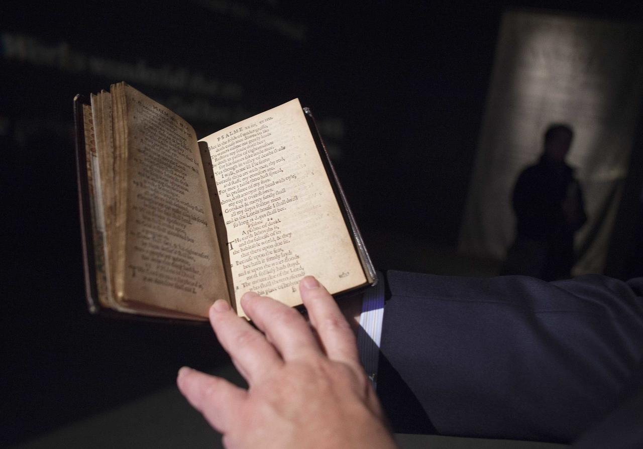 """David Redden, Worldwide Chairman of Sotheby's Books and Manuscripts department, displays a copy of """"The Bay Psalm Book"""" at Sotheby's Auction House in New York, November 21, 2013. Published in 1640, the Bay Psalm Book is considered the first book printed in what was then the British colonies of North America. With only eleven copies left in existence, Sotheby's expects the book to sell for up to $30 million U.S. dollars at auction on November 26. REUTERS/Carlo Allegri (UNITED STATES - Tags: MEDIA SOCIETY)"""