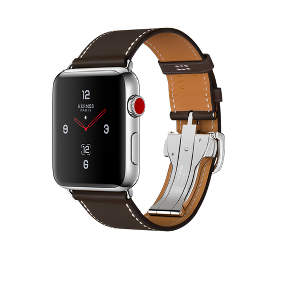 Apple Watch Hermès with a brown leather strap is pictured in a glossy advertisement featuring a white background