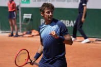 Switzerland's Henri Laaksonen reacts as he defeats Germany's Yannick Hanfmann during their first round match of the French Open tennis tournament at the Roland Garros stadium Sunday, May 30, 2021 in Paris. (AP Photo/Michel Euler)