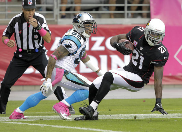Arizona Cardinals cornerback Patrick Peterson (21) intercepts a pass as Carolina Panthers wide receiver Steve Smith (89) defends during the first half of a NFL football game, Sunday, Oct. 6, 2013, in Glendale, Ariz. (AP Photo/Rick Scuteri)