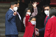 President-elect Pedro Castillo's son Arnold, daughter Alondra, front, and sister-in-law Yenifer Paredes wave as they enter Congress for Castillo's swearing-in ceremony in Lima, Peru, Wednesday, July 28, 2021. (AP Photo/Francisco Rodriguez)