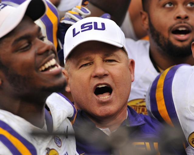 TAMPA, FL - JANUARY 1: Head coach Les Miles of the LSU Tigers celebrates after a 21-14 victory against the Iowa Hawkeyes January 1, 2014 in the Outback Bowl at Raymond James Stadium in Tampa, Florida. (Photo by Al Messerschmidt/Getty Images)