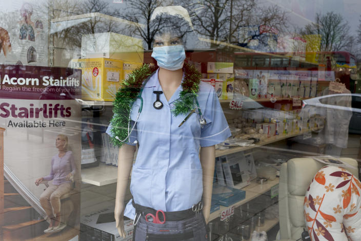 As the Coronovirus pandemic takes hold across the UK, with 53 cases now reported by health authorities, the window of a medical equipment business in south London, a surgical mask is worn by a nurse's mannequin, on 4th March 2020, in London, England. (Photo by Richard Baker / In Pictures via Getty Images)
