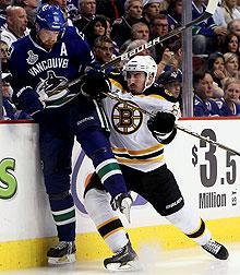 Marchand has been a thorn in the side of both Daniel (left) and Henrik Sedin