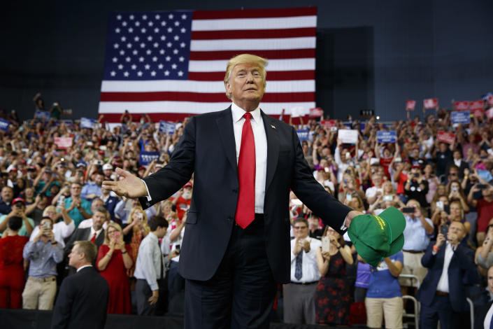President Trump arrives to speak at a campaign rally at Ford Center in Evansville, Ind., on Thursday, (AP Photo/Evan Vucci)