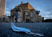 A face mask is shown in front of the Old Opera in Frankfurt, Germany, Saturday, Oct. 31, 2020. Germany's health minister says when a vaccine for the coronavirus is ready, it will be equally distributed among all European Union member nations. (AP Photo/Michael Probst)