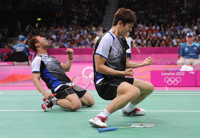 LONDON, ENGLAND - AUGUST 02: Yong Dae Lee (R) and Jae Sung Chung (L) of Korea celebrate beating Tontowi Ahmad and Lilyana Natsir of of Indonesia in their Men's Doubles Badminton quarter final on day 6 of the London 2012 Olympic Games at Wembley Arena on August 2, 2012 in London, England. (Photo by Michael Regan/Getty Images)