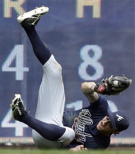 Atlanta Braves' Jordan Schafer makes a diving catch on a ball hit by Milwaukee Brewers' Jeff Bianchi during the sixth inning of a baseball game on Sunday, June 23, 2013, in Milwaukee. (AP Photo/Morry Gash)