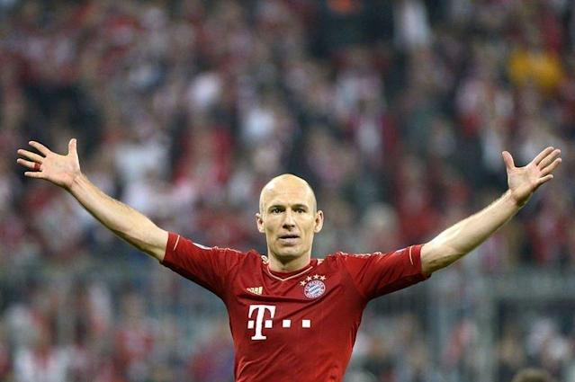 Bayern Munich's midfielder Arjen Robben celebrates scoring during their UEFA champions league semi-final first leg football match against Barcelona on April 23, 2013 in Munich, southern Germany. Bayern Munich won 4-0