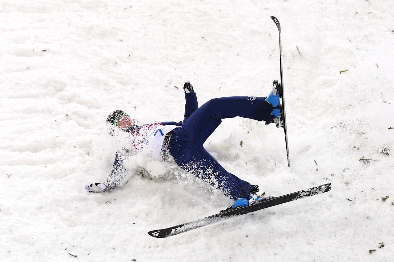 SOCHI, RUSSIA - FEBRUARY 14: Emily Cook of the United States crashes out competes in the Freestyle Skiing Ladies' Aerials Finals on day seven of the Sochi 2014 Winter Olympics at Rosa Khutor Extreme Park on February 14, 2014 in Sochi, Russia. (Photo by Cameron Spencer/Getty Images)