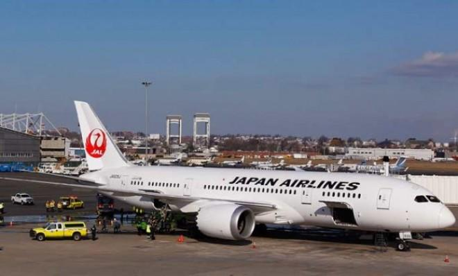 A Japan Airlines Boeing 787 Dreamliner is surrounded by emergency vehicles at Boston's Logan airport on Jan. 7 after a small electrical fire broke out in the cabin after landing.