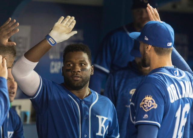 Kansas City Royals' Abraham Amonte, left, celebrates with teammates in the dugout after hitting a home run in the second game of their baseball double header against the Toronto Blue Jays, in Toronto on Tuesday, April 17, 2018. (Fred Thornhill/The Canadian Press via AP)