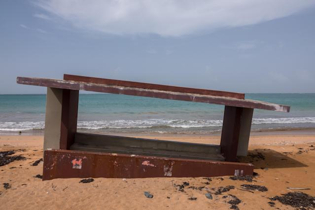 <p>A dugout from a baseball park is partially sunken on the sand of the Luquillo Beach, a victim of beach surge caused by Hurricane Maria, on Sept. 19, 2018 in Luquillo, Puerto Rico. (Photo: Angel Valentin/Getty Images) </p>
