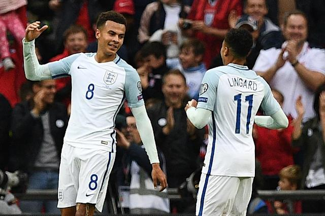 Dele Alli (left) celebrates with Jesse Lingard after scoring their England's second goal against Malta (AFP Photo/Justin Tallis)