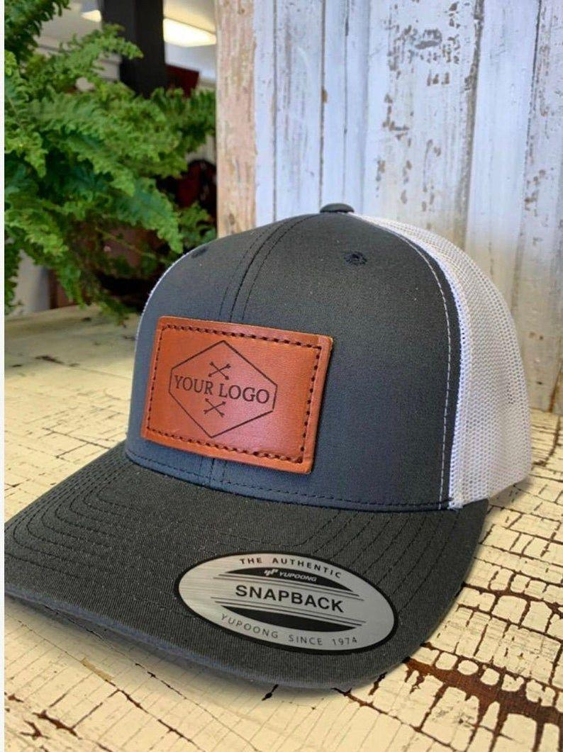 """<p><strong>SmuckerLeather</strong></p><p>etsy.com</p><p><strong>$27.50</strong></p><p><a href=""""https://go.redirectingat.com?id=74968X1596630&url=https%3A%2F%2Fwww.etsy.com%2Flisting%2F768611351%2Fcustom-leather-patch-hats-retro-classics&sref=https%3A%2F%2Fwww.womansday.com%2Frelationships%2Ffamily-friends%2Fg27467309%2Fpersonalized-gifts-for-dad%2F"""" rel=""""nofollow noopener"""" target=""""_blank"""" data-ylk=""""slk:Shop Now"""" class=""""link rapid-noclick-resp"""">Shop Now</a></p><p>You can add his name, nickname, initial and even a photo on this hat. """"I ordered a hat for my husband for Christmas. I was not expecting it to look so good. The quality of the leather patch is amazing,"""" one customer wrote. </p>"""
