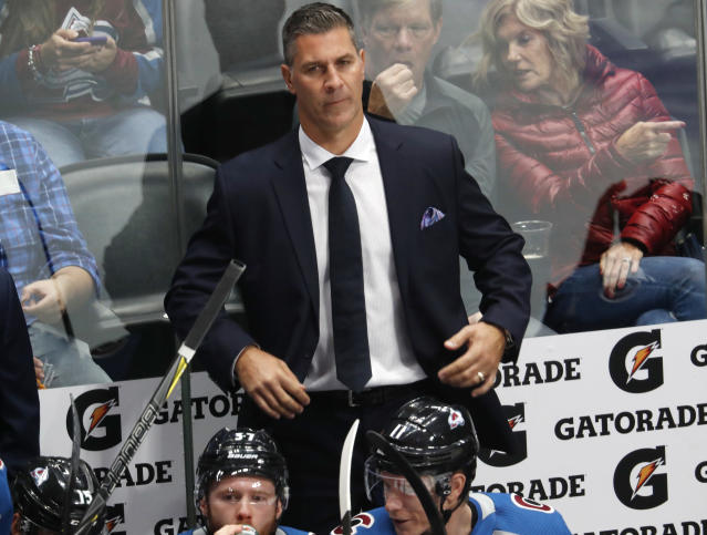 FILE - In this Thursday, Oct. 4, 2018 file photo, Colorado Avalanche coach Jared Bednar watches his team play the Minnesota Wild in the first period of an NHL hockey game in Denver. The Colorado Avalanche agreed to a two-year contract extension with coach Jared Bednar after guiding the team to back-to-back playoff appearances. His contract runs through the 2021-22 season, the team announced Tuesday, July 9, 2019. (AP Photo/David Zalubowski, File)